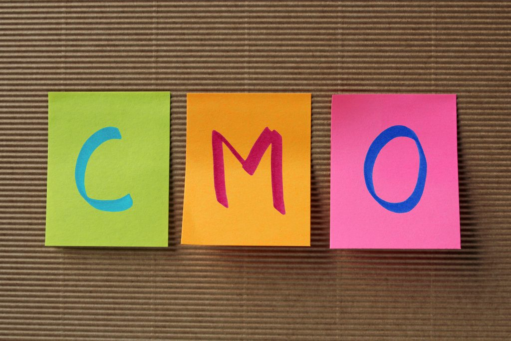CMO spelled out on PostIt
